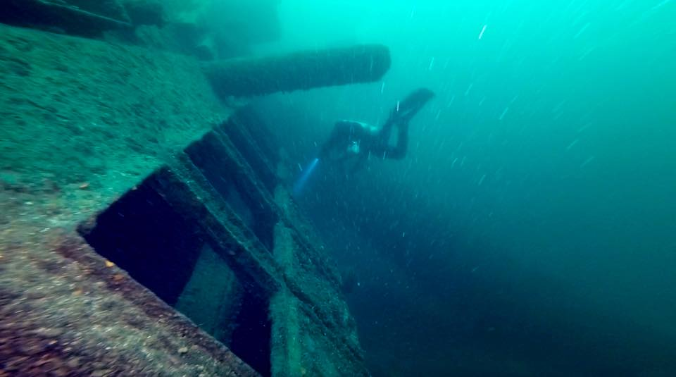 a DDS Diver Explores the Engine Hatches and smokestack on the Keystorm Shipwreck in 1000 Islands