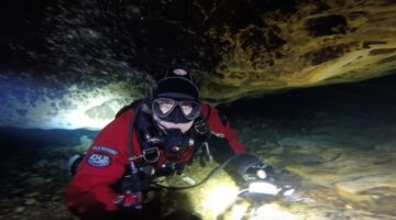 Cave Explorer Matt Mandziuk retrieving line in a Florida Cave