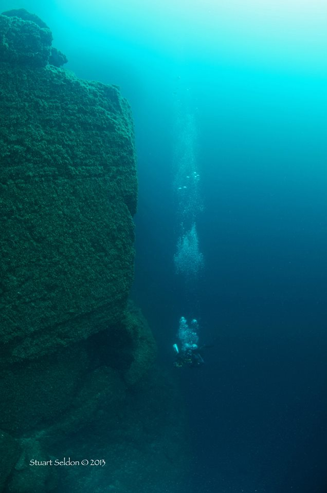 Going down to depth at Dufferin Wall in Tobermory