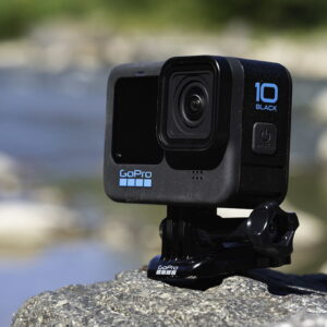 GoPro hero10 black with mount shown on a rock